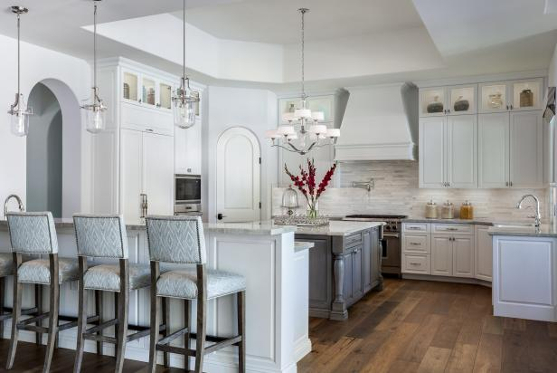 Kitchen With White Cabinets, Gray Kitchen Island and Hardwood Floors