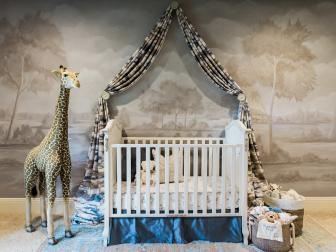 Stylish Nursery With Stuffed Animal Decor and Illustrated Wallpaper