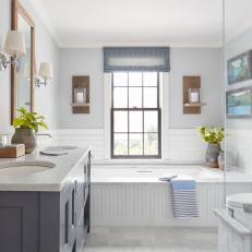 Gray Cottage Bathroom With Soaking Tub