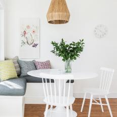 White Breakfast Nook With Graphic Pillows