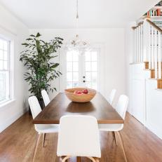White Transitional Dining Room With Houseplant
