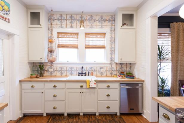 White Kitchen with Neutral and Blue Backsplash