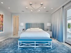 Contemporary Blue and White Bedroom With Bench