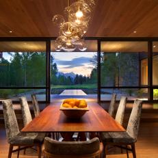 Modern Dining Room With Wood Paneling