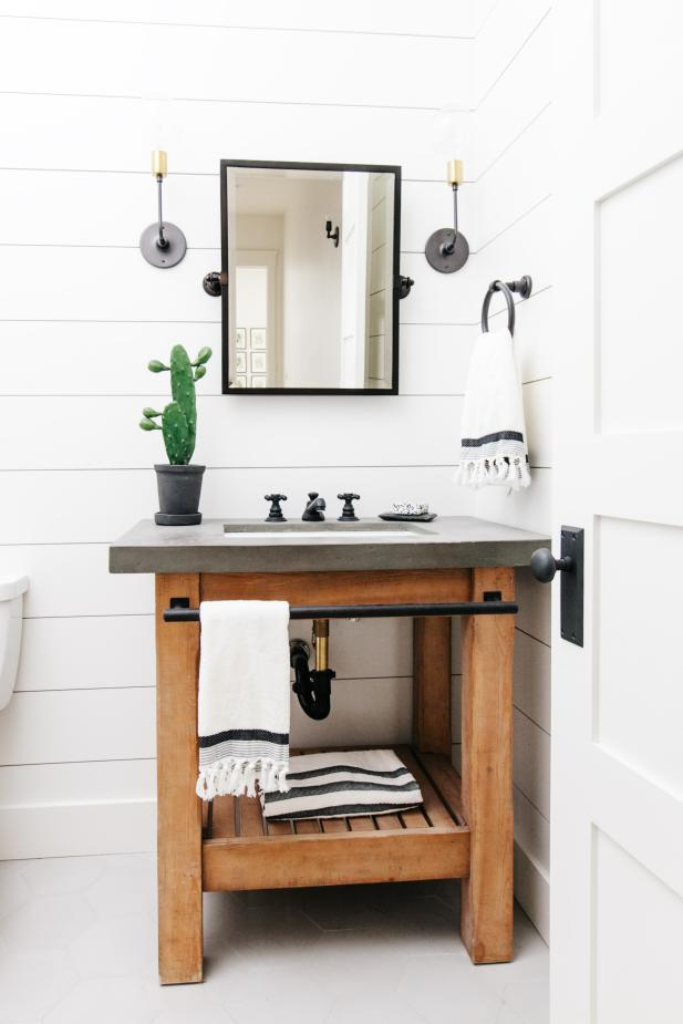 Edgy Black Details in White Powder Room