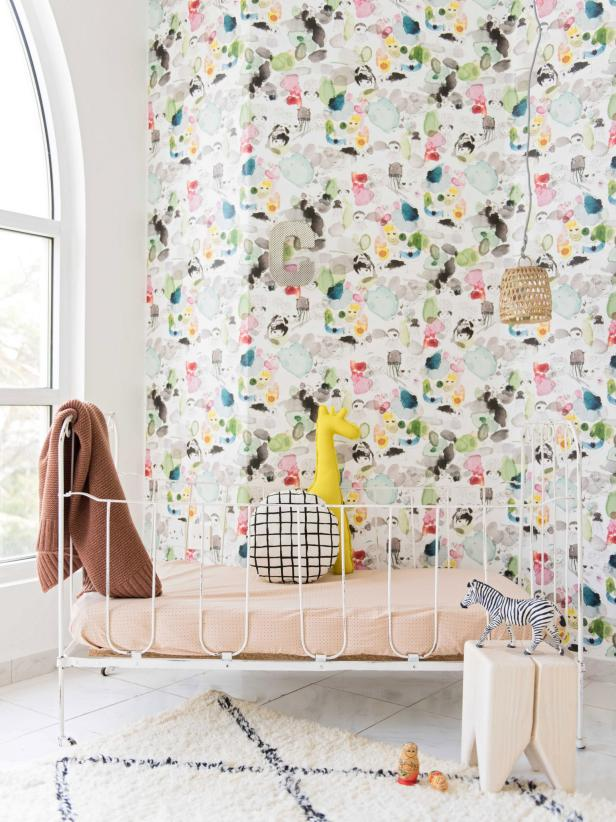 Eclectic Multicolor Nursery With White Metal Crib