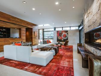 Great Room With Wall-Mount Fireplace, Red Rug and White Sofa