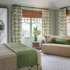 Guest Bedroom With Large Abstract Art and Floral Curtains