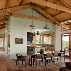 Rustic Dining Room With Industrial Pendant Lights