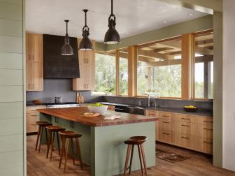 Green Open Kitchen With Industrial Pendants