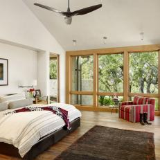 Contemporary Bedroom With Red Armchair
