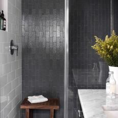 Tall Glass Shower With Black Tiling