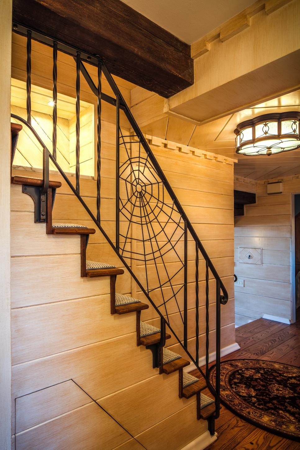 Stair Rail with Custom Wrought Iron Spiderweb Design