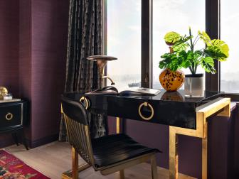 Desk in Purple Bedroom With City View