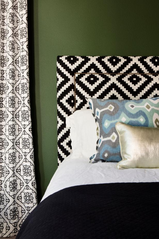 Green Bedroom With Black and White Headboard