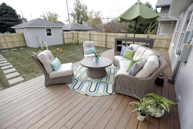 Neutral Deck with Wicker Chairs and Beige Cushions