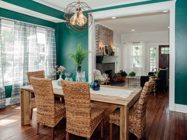 Green Dining Room with Gold Globe Light Fixture