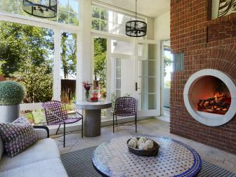 Porch Sitting Room With Round Fireplace