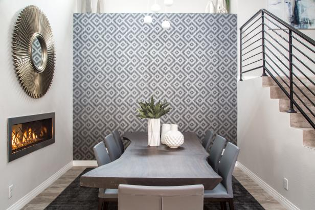 Dining Room With Two Sided Fireplace and Graphic Wallpaper