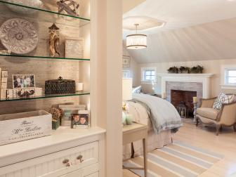 Attic Bedroom With Fireplace and Built-In Display Shelves