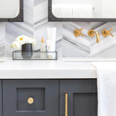 Dark Gray Bathroom Vanity With Brass Hardware U0026 Chevron Wall