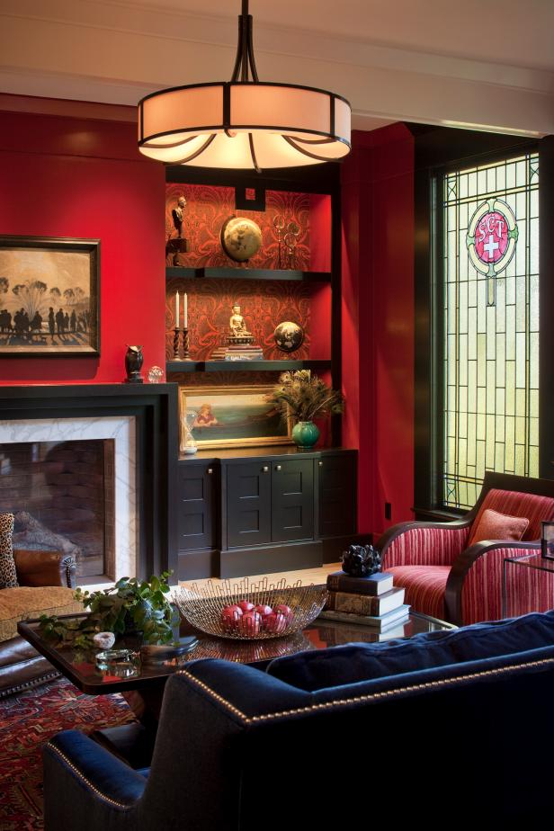 Red Living Room With Navy Sofa and Wallpaper-Lined Built-In Shelves
