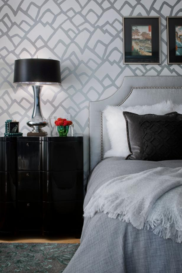Bedroom With Silver Abstract Wallpaper and Nailhead-Trim Headboard