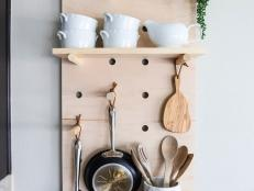 If your kitchen cabinets and drawers are overcrowded, create more storage space with this easy-to-make oversized pegboard shelving system. You can customize the shelves and pegs to stylishly display your favorite pots, pans and utensils.