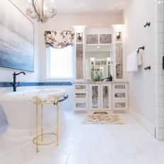 Bright and Airy Spa Bathroom With Shimmering Gold Details