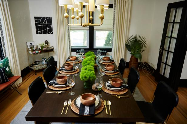 Brown and White Dining Room with Gold Light Fixture