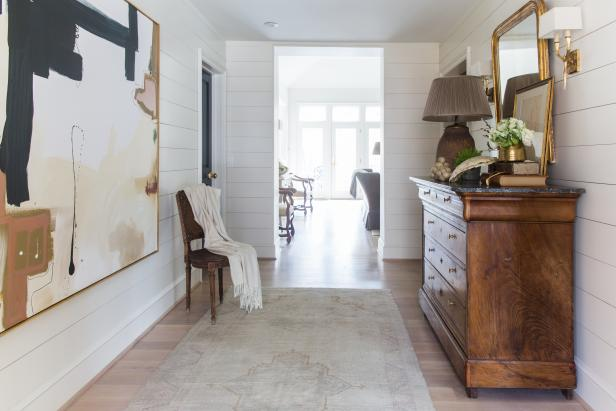 Chic Farmhouse Entryway with Artwork and Bleached Floors