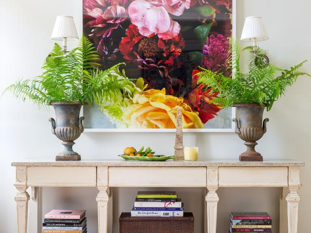 Bold and Colorful Floral Wall Art and Accessories Above a Table