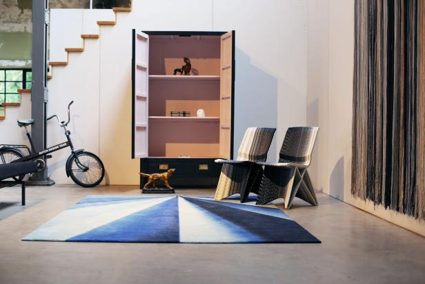 Minimal Living Room with Chairs, Blue and White Rug and Bicycle