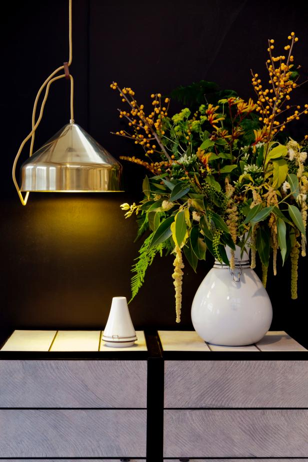 Modern Decor with Copper Light and White Vase