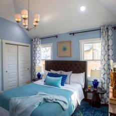 Contemporary Blue Master Bedroom with Brown Headboard