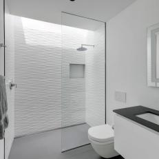 Modern White Bathroom With Glass Shower And Gray Tile Floor