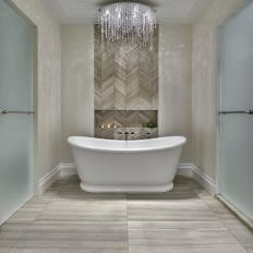 Master Bathroom Tub With Herringbone Wall Tile Crystal Chandelier And Frosted Gl Doors