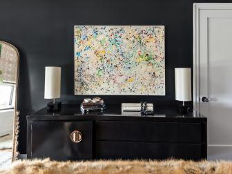 Artwork and Vintage Dresser in Jet Black Master Bedroom