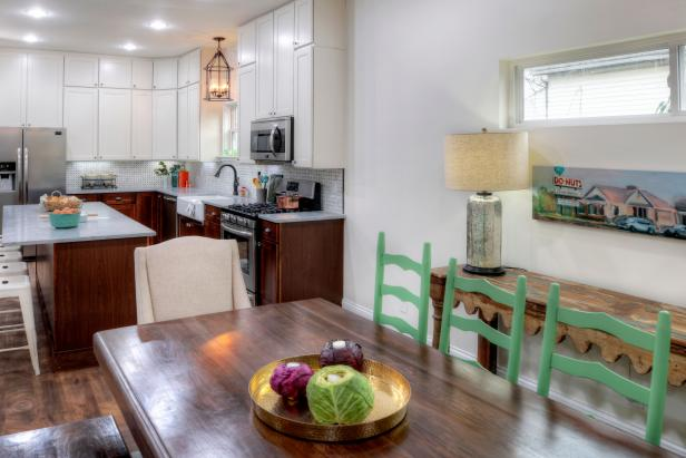 White Kitchen/Dining Room with Brown Wood Table and Green Chairs