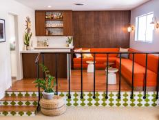 Midcentury Bar and Lounge With Orange Banquette