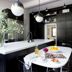 Kitchen With Black Cabinets and Island Plus Globe Pendants