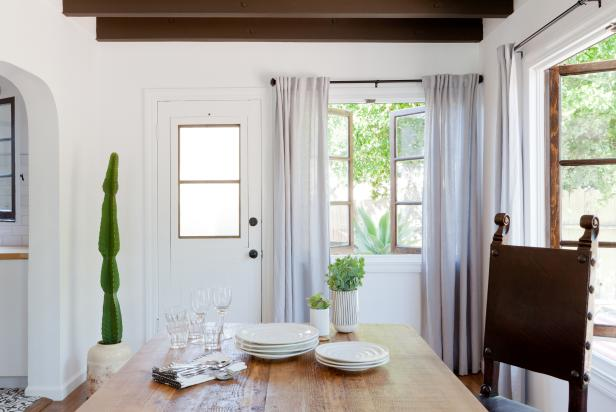 White Dining Room With Casement Window and Cactus Plant