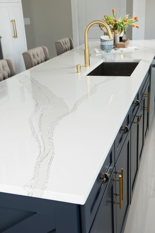 White Cambria Quartz Countertop on Wide Blue Kitchen Island