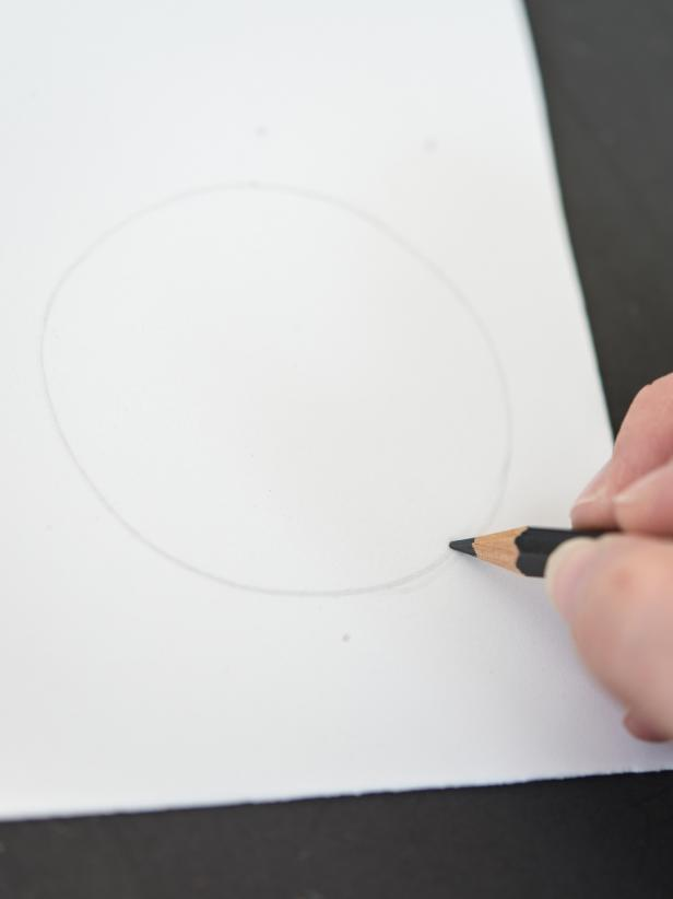 On white craft foam, use pencil to draw out a circle, about 3â in diameter. Cut out with scissors. Use first circle as a template to trace second white circle. Cut out second circle. Repeat this process with black foam, making two circles about 1/2â in diameter. Tip: Trace a drinking glass to create two white circles.