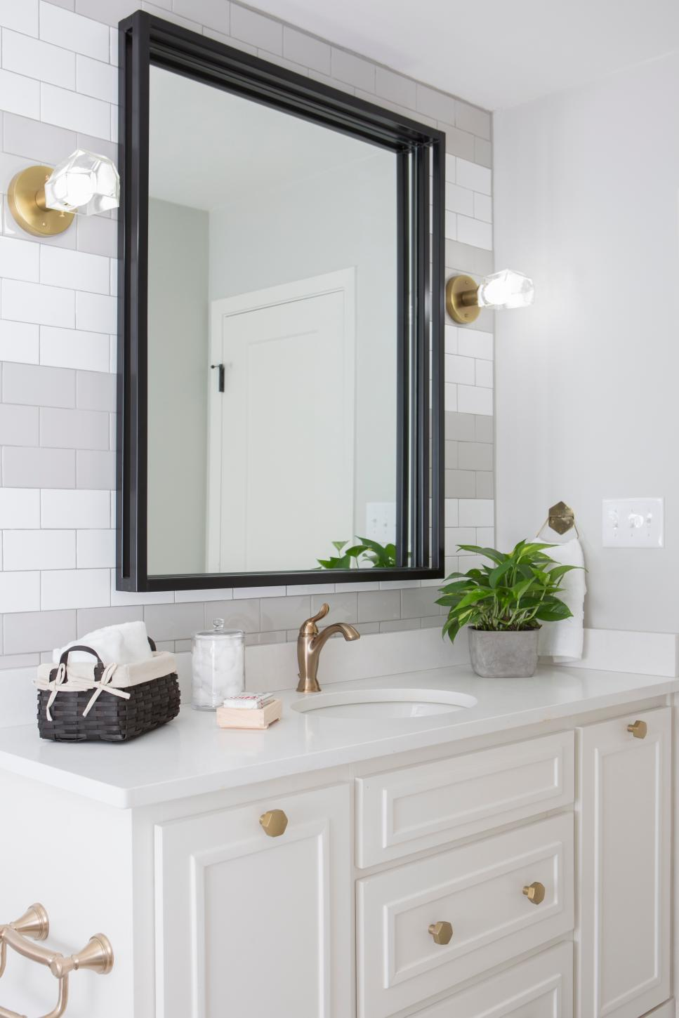White Bathroom with Glass Sconces