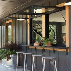 Black Contemporary Back Porch with Bar