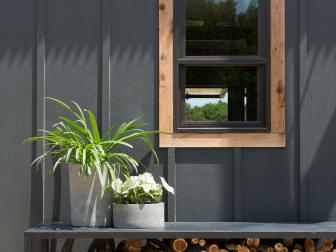 Black Cabin Home Exterior with Neutral Window Frame
