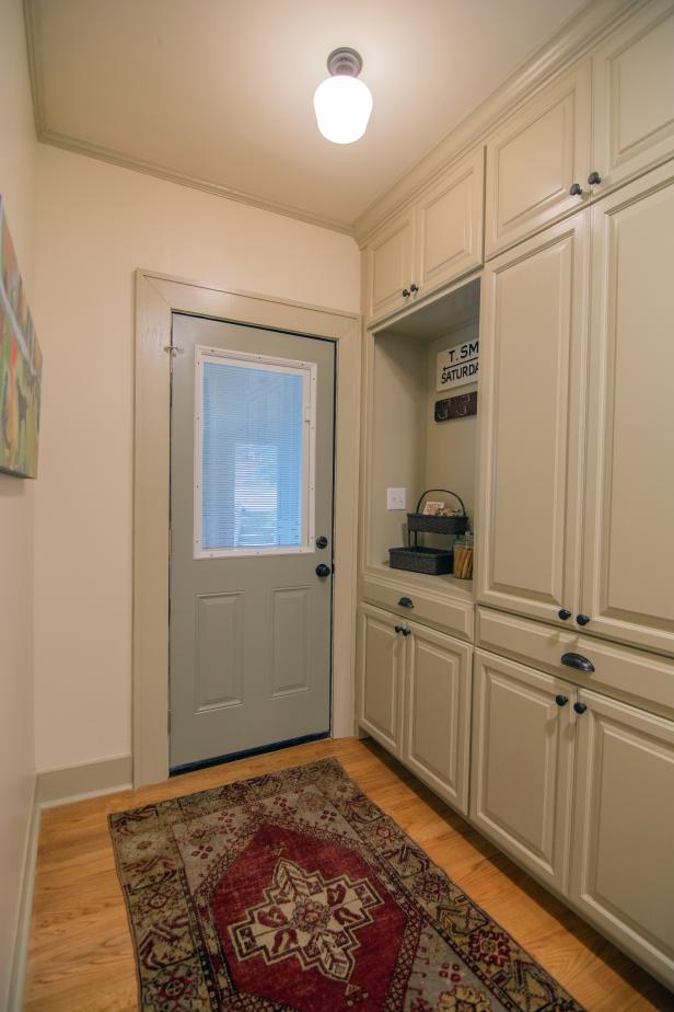 Neutral Mudroom with Beige Cabinets