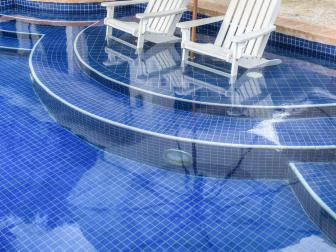 Stylish White Lounge Chairs in Pool