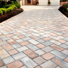 Stone Paver Driveway Brings Warmth and Texture to Home's Exterior